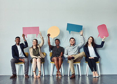 Buy stock photo Studio portrait of a group of businesspeople holding colourful speech bubbles against a grey background