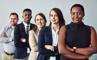 Buy stock photo Shot of a group of businesspeople waiting in line for their upcoming interviews