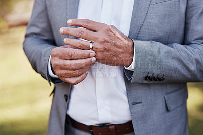 Buy stock photo Cropped shot of an unrecognizable bridegroom adjusting his ring on his wedding day