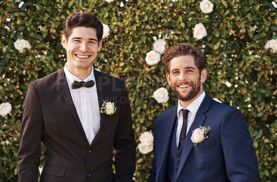 Buy stock photo Cropped portrait of a handsome young bridegroom smiling while standing with his best man on his wedding day