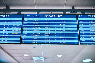 Buy stock photo Cropped shot of departure and arrival announcement boards in an international airport during the day