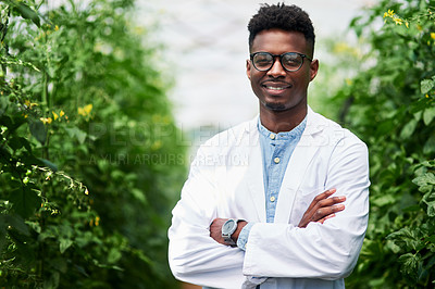 Buy stock photo Portrait of a handsome young botanist posing with his arms folded outdoors in nature