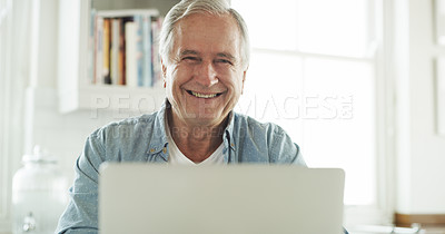Buy stock photo Cropped shot of a senior man using his laptop while sitting at home