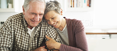 Buy stock photo Cropped shot of a loving senior couple spending time together at home