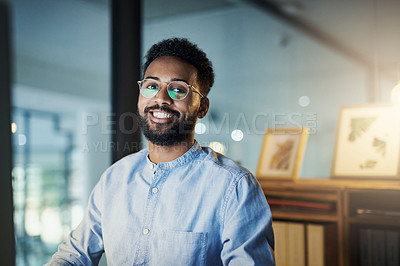 Buy stock photo Portrait of a young businessman working in an office at night