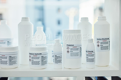 Buy stock photo Closeup shot of bottles of chemicals in a lab