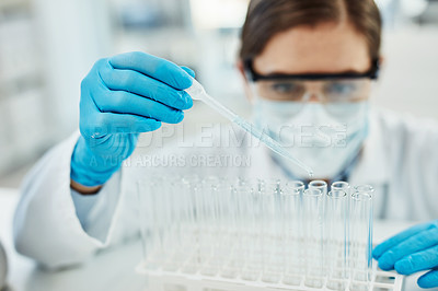 Buy stock photo Shot of a young scientist working with medical samples in a lab