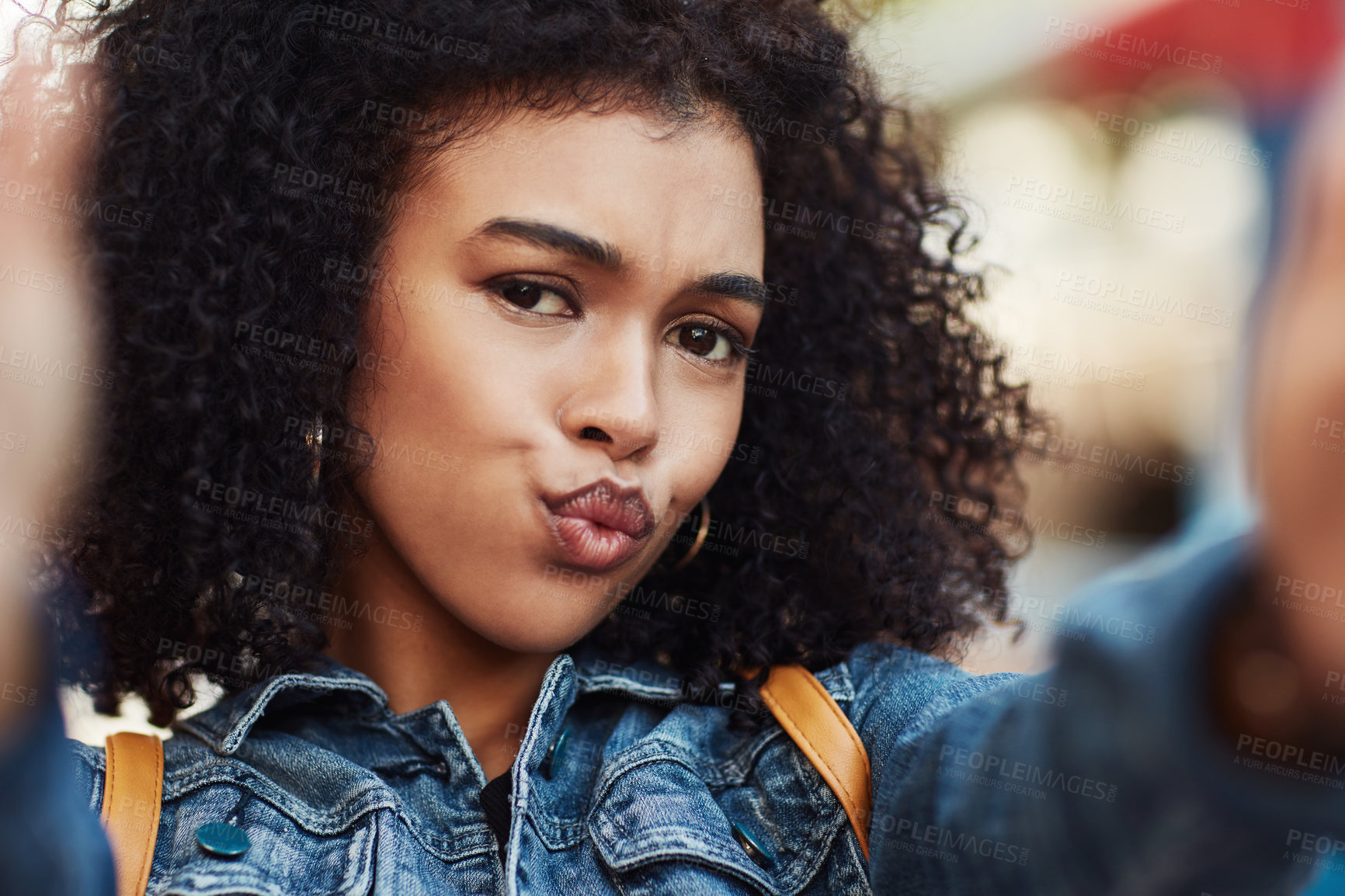 Buy stock photo Portrait of an attractive and cheerful young woman taking selfies while relaxing outdoors in the city