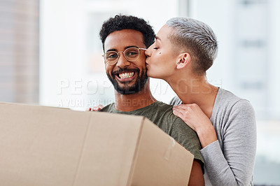 Buy stock photo Shot of a young couple moving into their new house