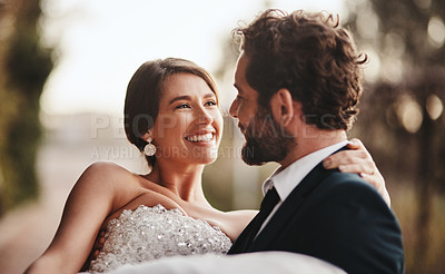 Buy stock photo Cropped shot of a man carrying his bride on their wedding day