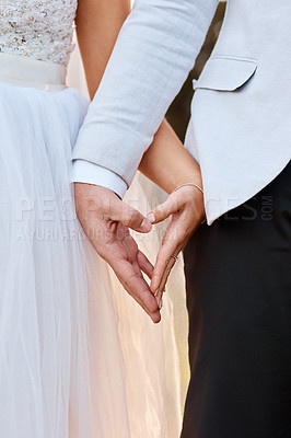 Buy stock photo Cropped shot of an unrecognizable couple holding hands on their wedding day