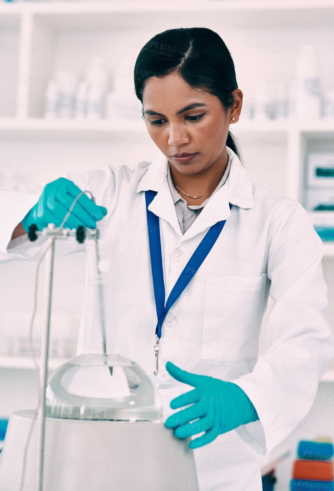 Buy stock photo Cropped shot of an attractive young female scientist working with a centrifuge in a laboratory