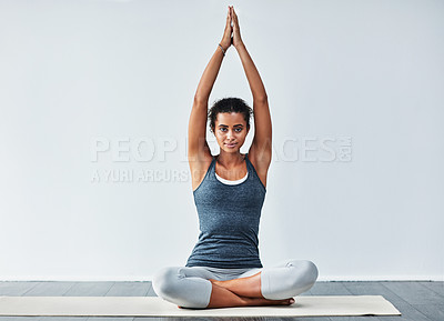 Buy stock photo Shot of a sporty young woman practising yoga