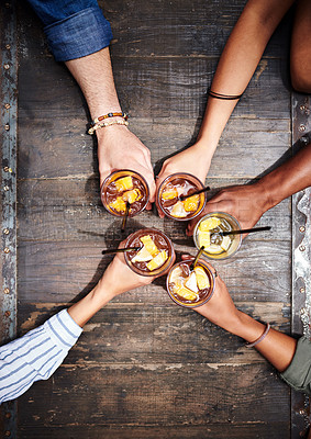 Buy stock photo Cropped high angle shot of a group of friends toasting with their drinks at a restaurant