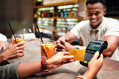 Buy stock photo Cropped shot of a customer paying for drinks with a credit card at a restaurant