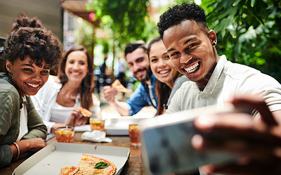 Buy stock photo Shot of a group of young friends taking selfies while having pizza at a restaurant