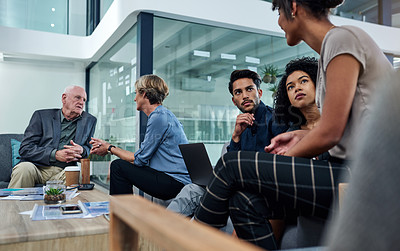 Buy stock photo Shot of a group of businesspeople planning and discussing ideas together in their office lounge area at work