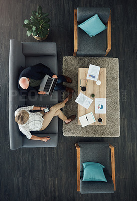Buy stock photo High angle shot of two businesspeople having a discussion in an office