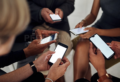 Buy stock photo Cropped shot of an unrecognizable group of businesspeople using their smartphones together in synchronicity at work