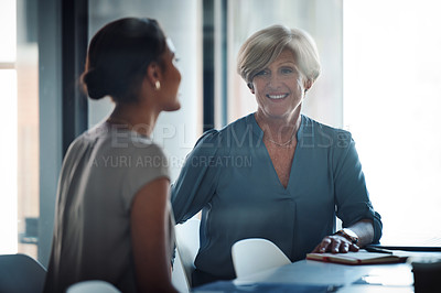 Buy stock photo Shot of an attractive mature businesswoman having a conversation with a client at work