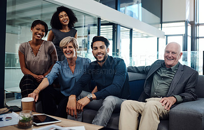 Buy stock photo Portrait of a group of businesspeople posing together in the lounge area at work