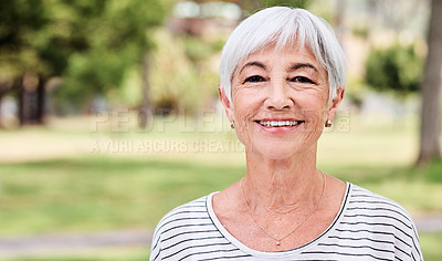 Buy stock photo Cropped shot of a senior woman spending the day outdoors