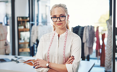 Buy stock photo Shot of a successful young fashion designer in her workshop
