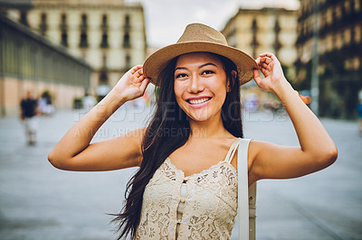 Buy stock photo Cropped shot of an attractive young woman standing alone in the city during a vacation in Spain
