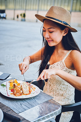 Buy stock photo Cropped shot of an attractive young woman sitting alone and enjoying a meal at a cafe in Spain