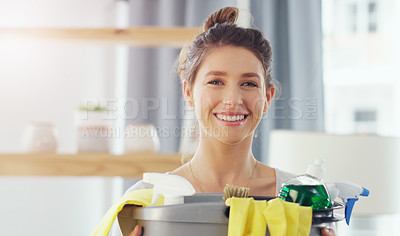 Buy stock photo Closeup shot of a young woman holding a bucket with cleaning supplies at home