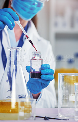 Buy stock photo Closeup of an unrecognizable scientist adding a chemical into a test tube inside of a laboratory during the day