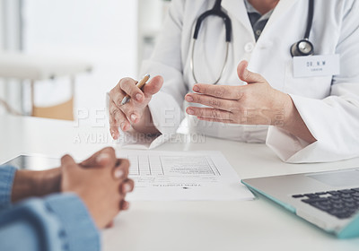 Buy stock photo Cropped shot of an unrecognizable female doctor having a discussion with a female patient in her office