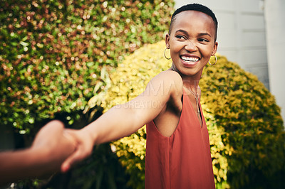 Buy stock photo Cropped shot of a happy young woman pulling her partner by the hand