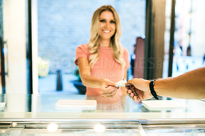 Buy stock photo Shot of a young woman paying at the checkout of an ice cream parlour with Euros