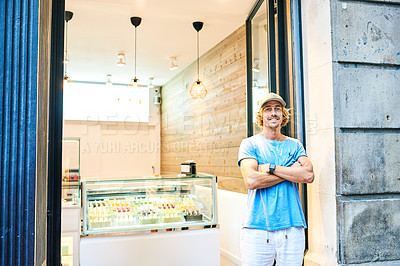 Buy stock photo Portrait of a confident young man working in an ice cream parlour
