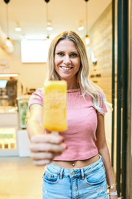 Buy stock photo Portrait of a happy young woman buying a delicious ice cream