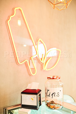 Buy stock photo Shot of a tip jar on a counter in an ice cream parlour