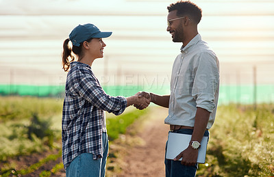 Buy stock photo Cropped shot of two young farmers shaking hands while working on their farm