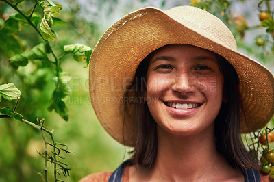 Buy stock photo Portrait of an attractive young female farmer posing outdoors in the fields at her farm