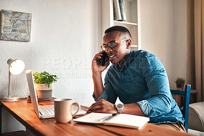 Buy stock photo Cropped shot of a young businessman working from home