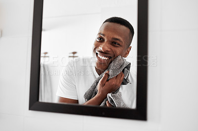 Buy stock photo Cropped shot of a man looking into the mirror while drying his face with a towel