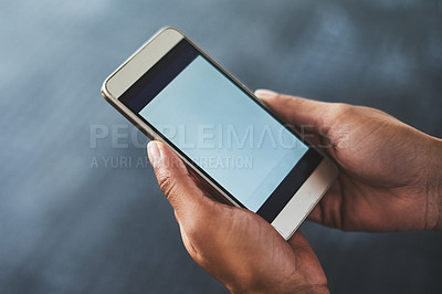 Buy stock photo Cropped shot of a woman using a smartphone in a gym