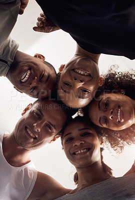 Buy stock photo Low angle shot of a group of young people huddling in solidarity at a gym