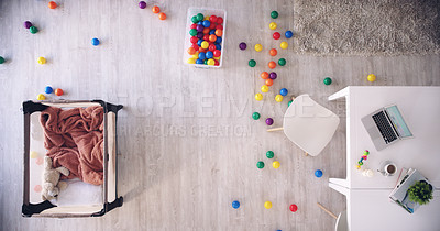 Buy stock photo High angle shot of colourful balls on a floor in a lounge area in a house