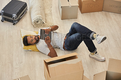 Buy stock photo Shot of a handsome young man moving into his new house