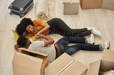 Buy stock photo Shot of a happy young couple moving into their new house