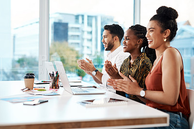 Buy stock photo Cropped shot of a diverse group of businesspeople sitting in the office together and clapping
