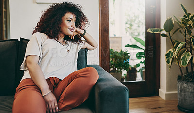 Buy stock photo Cropped shot of an attractive young woman relaxing on the sofa at home