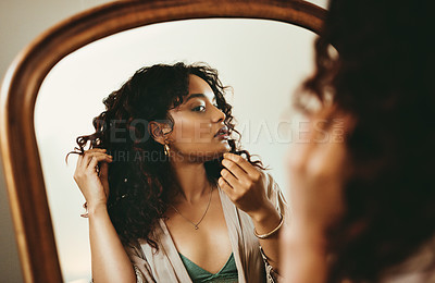 Buy stock photo Cropped shot of an attractive young woman looking at herself in the mirror in her bedroom