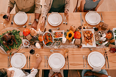 Buy stock photo High angle shot of a group of friends having a Thanksgiving meal together